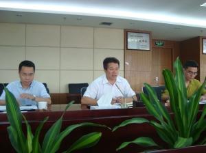 Mr. Wang Quang Ming (baju putih)